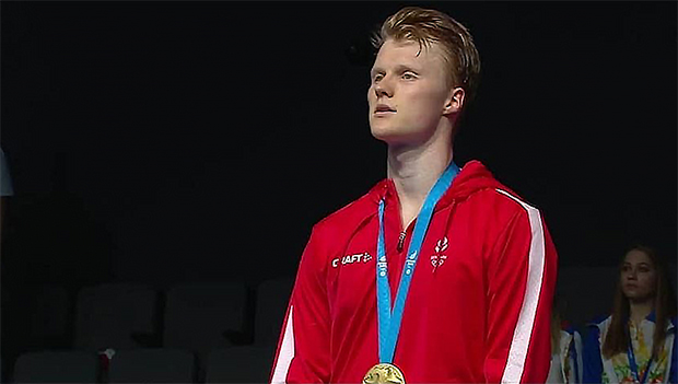 Anders Antonsen stands on the podium for the Denmark National Anthem following his victory in the men's singles final. (photo: European Games, Minsk)