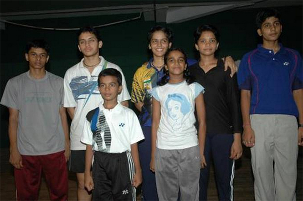 First row: PV Sindhu (center-right) with future Olympic bronze medalist Saina Nehwal (back row, center), Sikki Reddy (back row, 2nd right), Parupalli Kashyap (back row, 2nd left) and other winners of the all-India junior ranking badminton tournament in Kochi in June 2005. (photo: PTI)