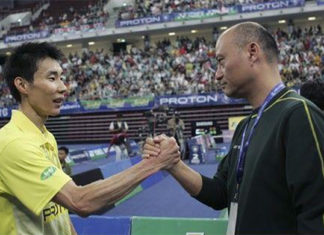 Li Mao (R) re-join the Chinese Badminton Association as their men's singles coach. (photo: AFP)