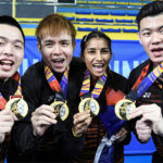 Aaron Chia (from left), Soh Wooi Yik, Selvaduray Kisona and Lee Zii Jia display their SEA Games gold medals. (photo: Bernama)