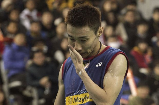 Lee Chong Wei reacts after losing a point to Chen Long of China in the men's singles final of the Korean Open on Sunday. The Malaysian world No.1 lost the match in straight sets.