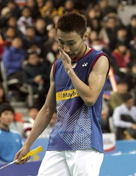 Malaysia's Lee Chong Wei looks down after losing a point against China's Chen Long during their men's singles final match at the Korea Open Badminton tournament in Seoul, South Korea, Sunday, Jan. 12, 2014. Chen won the match 21-14, 21-15.