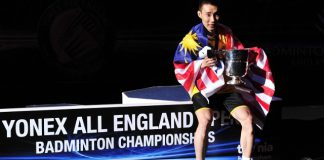 Lee Chong Wei of Malaysia poses with his trophy after beating Chen Long of China in their All England Open Badminton Championships men's singles final match in Birmingham, central England. (AFP/CARL COURT)