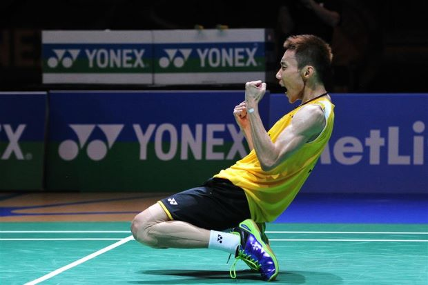 Lee Chong Wei sinks to his knees after winning the All-England men's singles title, beating defending champion Chen Long in straight sets in the final on Sunday. - AFP