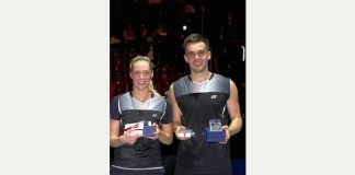Swiss cheese: Gabby and Chris Adcock smile for the camera after victory