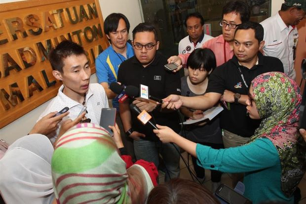 Lee Chong Wei speaking to the media after receiving a cheque worth RM80,000 from the Badminton Association of Malaysia at the Juara Stadium in Bukit Jalil on Thursday. — ART CHEN / The Star