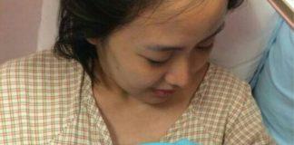 Koo Kien Keat's wife Audrey Tan Su Ven is holding their newborn son Dayson.
