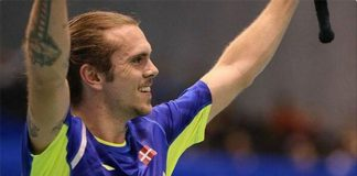 Jan O Jorgensen waves to the crowd after defeating Lin Dan 19-21, 21-13, 16-21 in the quarter final of Japan Open