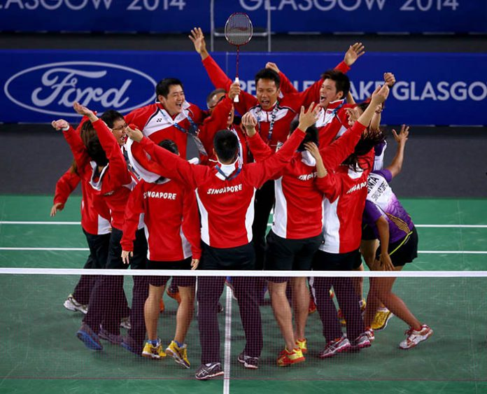 Singapore players storm the court to celebrate their bronze medal victory