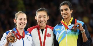 Canada's Michelle Li, gold medallist, is flanked by Scotland's Kirsty Gilmour, left, silver medallist, and India's PV Sindhu, right, bronze medallist, after the women's singles badminton final at the Commonwealth Games in Glasgow, Scotland on Sunday, August 3, 2014.