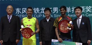 Lin Dan laughs with K. Srikanth on the podium at the China Open Super Series Premier event