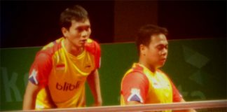 Muhammad Ahsan and Markis Kido play the first men's doubles for Indonesia at the 2014 Axiata Cup