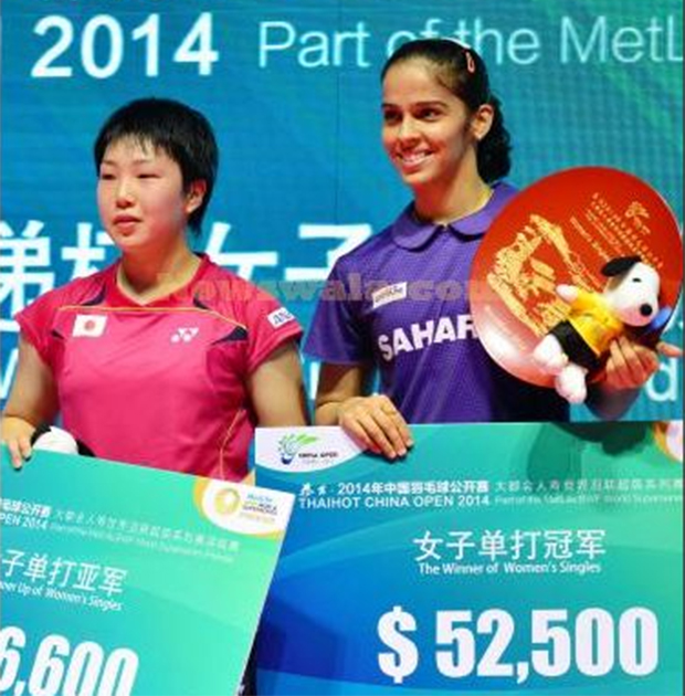 Indian shuttler Saina Nehwal winning her maiden China Open Super Series Premier women's singles title against Japan's Akane Yamaguchi (left) in Fuzhou, China on Nov 16, 2014.