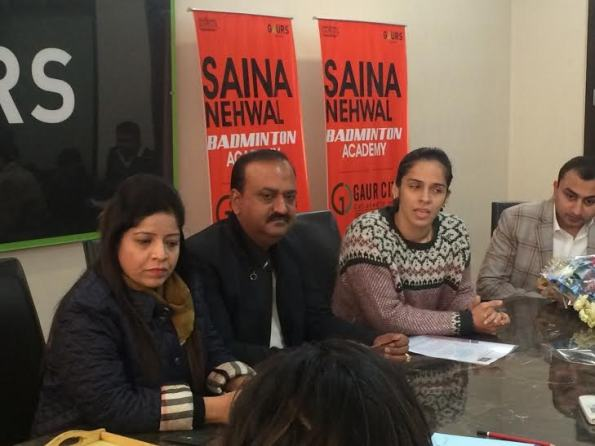 Saina Nehwal (second right) announces her own badminton academy