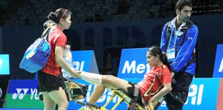 Leg injury: Indonesian women's doubles shuttler Nitya Krishinda Maheswari (center) is carried off court in a wheelchair by an official helped by her playing partner Greysia Polii (left) during the match against Japan's Reika Kakiiwa and Miyuki Maeda in the BWF Super Series Finals 2014 in Dubai, United Arab Emirates, earlier this month. They withdrew from the third game after Nitya sustained an injury to her left foot. Badmintonindonesia.org