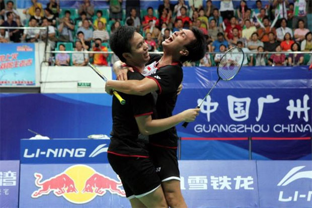Mohammad Ahsan (right) and partner Hendra Setiawan celebrate after winning the 2013 men's doubles world championships