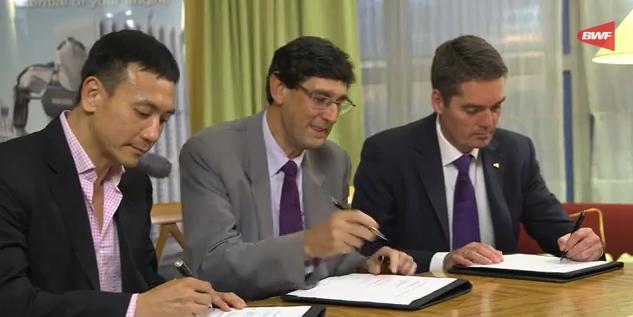 BWF President Poul-Erik Høyer Larsen (right) signs the agreement with Total energy