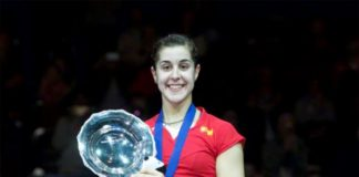 Carolina Marin with the trophy after winning the All England Open