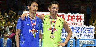 Lin Dan (right) beats Tian Houwei to win his fourth Badminton Asia Championships title on Sunday.
