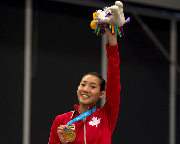 Michelle Li waves to the crowd on the podium after winning the 2015 Pan Am women's singles title. (photo: Peter J. Thompson/National Post)