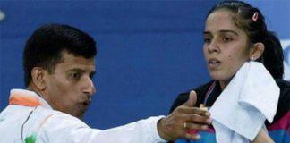 India's badminton ace Saina Nehwal and her coach Vimal Kumar.