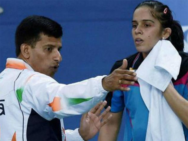 India's badminton ace Saina Nehwal and her coach Vimal Kumar.