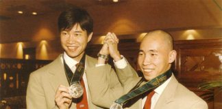 Cheah Soon Kit (left) and Yap Kim Hock pose with their 1996 Olympic silver medals.