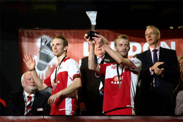 Mathian Boe (L) and Carsten Mogensen (R) of Denmark lift the 2013 London Badminton Grand Prix trophy.
