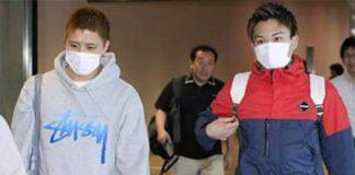Kento Momota (r) and Kenichi Tago arrive at Narita airport Thursday morning.
