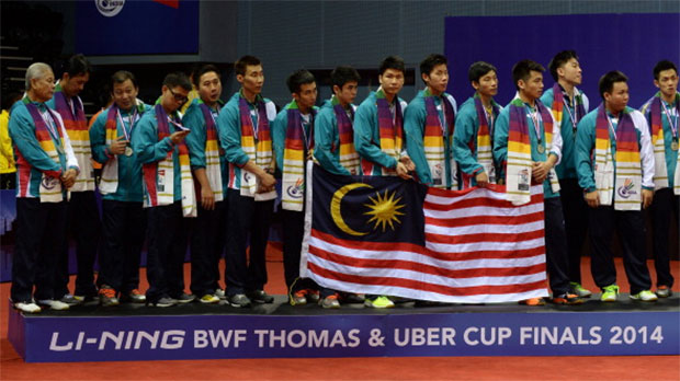 Members of the Malaysia men's badminton team pose on the podium as runners-up following a 2-3 defeat to Japan in the 2014 Thomas Cup final. (photo: GettyImages)