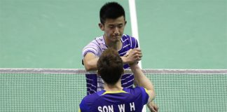 Chen Long (top) and Son Wan Ho of South Korea shake hands after their first men's singles match in the 2016 Thomas Cup. (photo: AFP)
