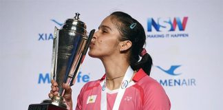 Saina Nehwal kisses the trophy after winning the Australian Open women's singles final. (photo: AFP)