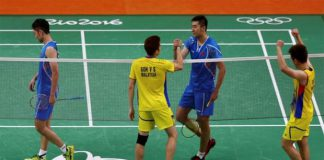 Goh V Shem and Tan Wee Kiong of Malaysia shake hands with Chai Biao and Hong Wei (CHN) of China after winning their semi-final match. (photo: Reuters)