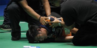 Pannawit Thongnuam receives medical attention after collapsing on court.