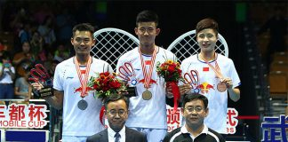 Chen Long (middle) wins his first Badminton Asia Championships in Wuhan on Sunday.