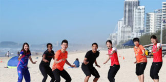 Sung Ji Hyun of Korea (from left), PV Sindhu of India, Zheng Siwei of China, Jonatan Christie of Indonesia, Misaki Matsutomo of Japan, Chen Qingchen of China and Ayaka Takahashi at Surfers Paradise Beach. (photo: Chris Hyde)