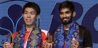 Kidambi Srikanth and Kazumasa Sakai share podium after the Indonesia Open men's singles final. (photo: AP)