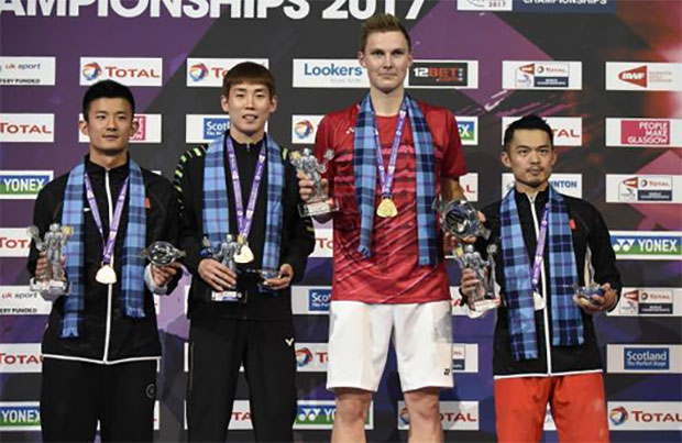 Viktor Axelsen poses with Lin Dan (right), Chen Long (far left), and Son Wan-Ho on the podium after winning the 2017 men's singles World Champion. (photo: AP)