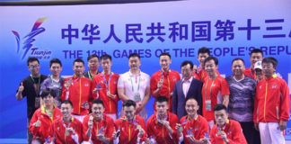 Lin Dan and Beijing's men's team lift trophies after winning the China National Games final in Tianjin. (photo: Lin Dan)