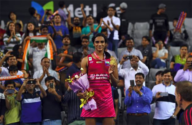 P.V Sindhu poses with her Korea Open medal. (photo: AP)