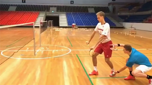 Viktor Axelsen mocks the new BWF rule that will limit the service height to 1.15m starting from All England 2018. This new rule will cause inconvenience to tall players such as Viktor Axelsen with height of 194cm and Mads Pieler Kolding of Denmark with height of 203cm. (photo: Axelsen's Youtube)