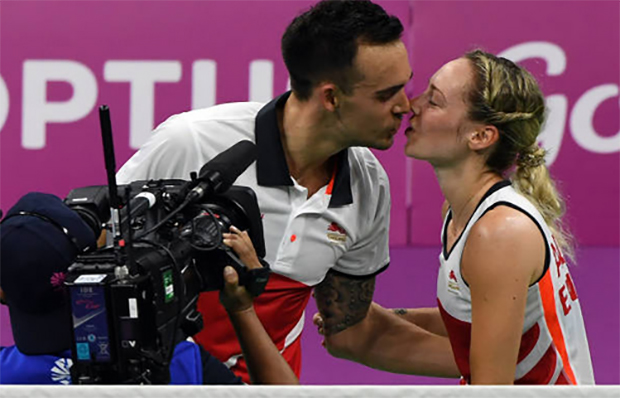 Chris and Gabby Adcock celebrate after successfully defended their mixed doubles gold medal. (photo: AP)