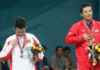 Taufik Hidayat beats Lin Dan 21-15, 22-20 to win the 2006 Asian Games men's singles title in Doha.