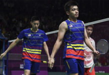 Goh V Shem/Tan Wee Kiong go down in straight-set to Marcus Fernaldi Gideon/Kevin Sanjaya Sukamuljo in Asian Games quarter-finals. (photo: Bernama)