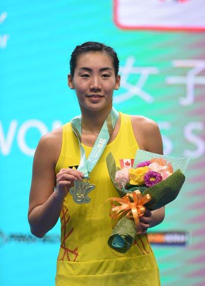 Michelle Li smiles as she celebrates her Macau Open victory. (photo: AFP)