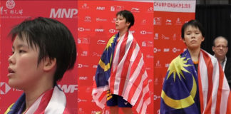 Goh Jin Wei stands on the podium for the Malaysia national anthem after winning the world junior gold. (photo: BadmintonCanada)