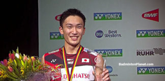 Kento Momota holds the German Open trophy after beating teammate Kenta Nishimoto in the final.