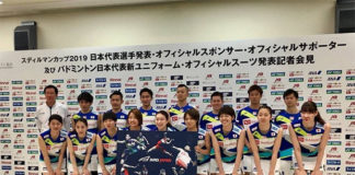 Kento Momota and the Japanese team carry a poster printed with a logo that looked similar to a bird's beak during the press conference on Wednesday. (photo: NBA)