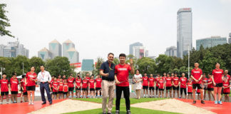 Poul-Erik Hoyer Larsen officiates the AirBadminton launch with Dong Jiong. (photo: BWF)