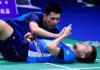 Teo Ee Yi's face is marred by sweat and blood during the 2019 Sudirman Cup quarter-final. (photo: AFP)